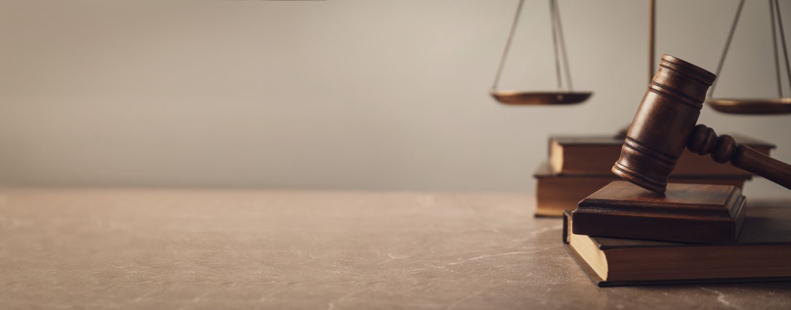 Wooden gavel with scales of justice and books on lawyer's table, space for text. Banner design